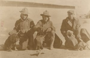 Sidney Hinson and two others with dogs and a prairie dog